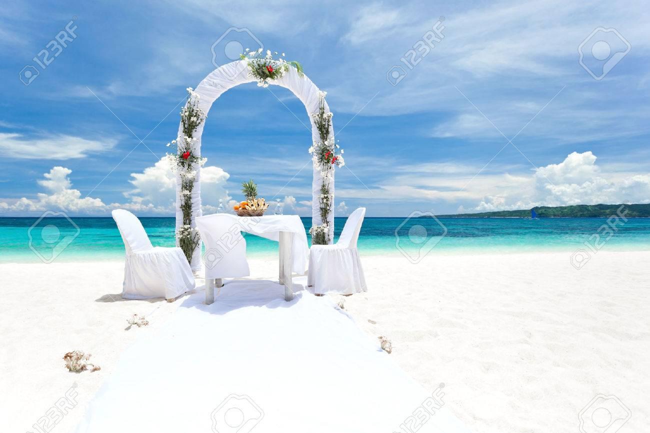 Beautiful wedding arch on tropical beach, nobody. Travel wedding Stock Photo - 24963906