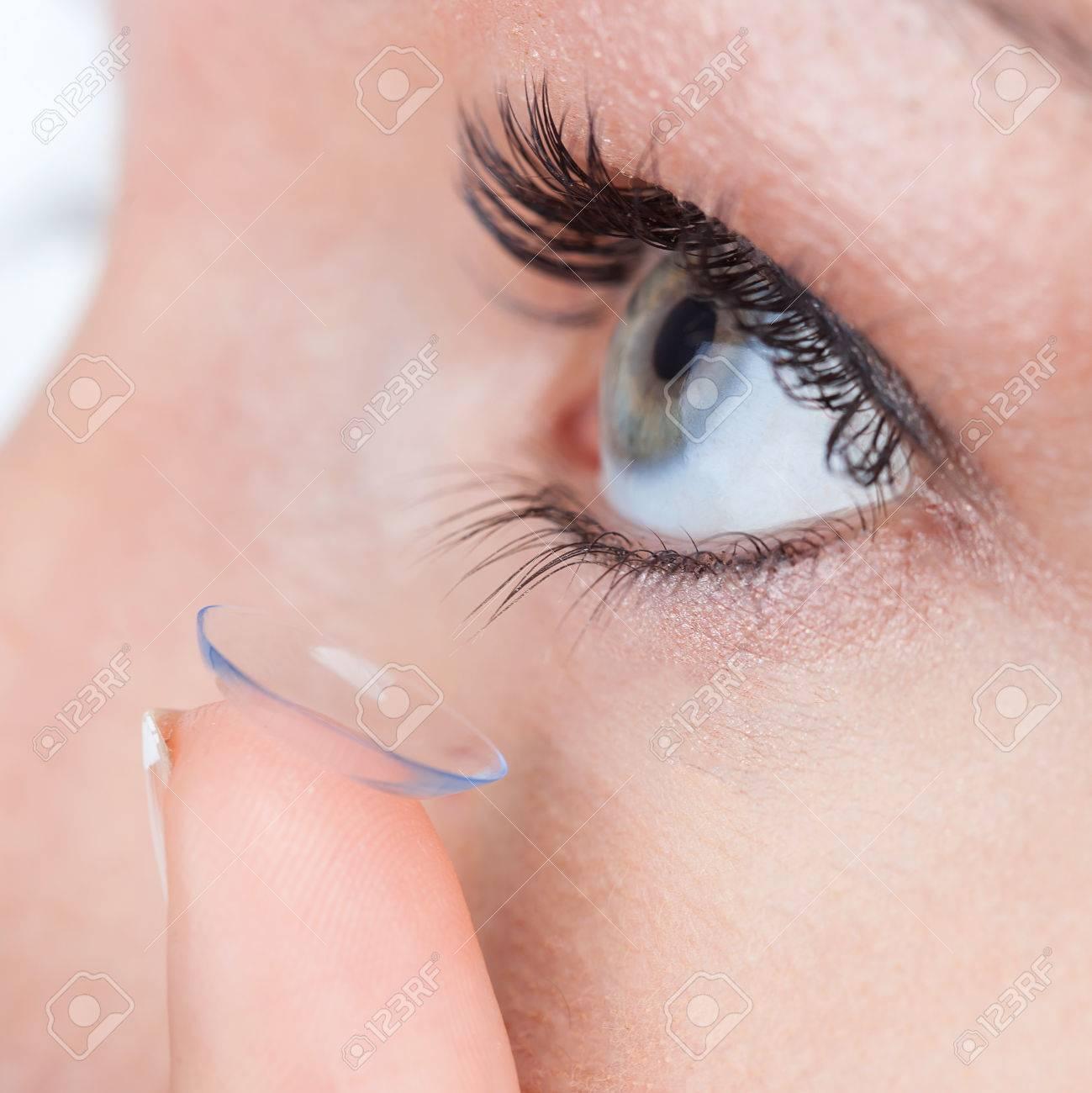 Woman eye with contact lens applying, macro Stock Photo - 30224172