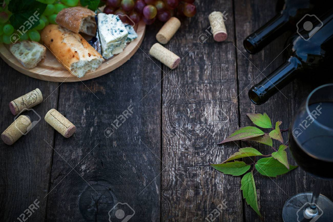 Wine bottles with grape leaves on wooden background with copy space Stock Photo - 41203414