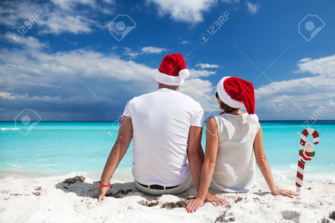 Happy couple celebrating Christmas on beach Stock Photo - 42838206