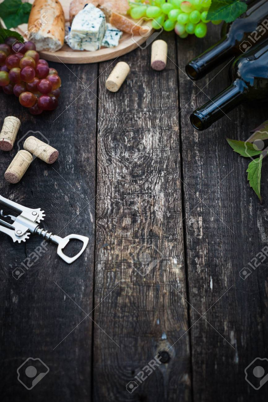 Wine bottles with grape leaves on wooden background with copy space, selective focus Stock Photo - 43177315