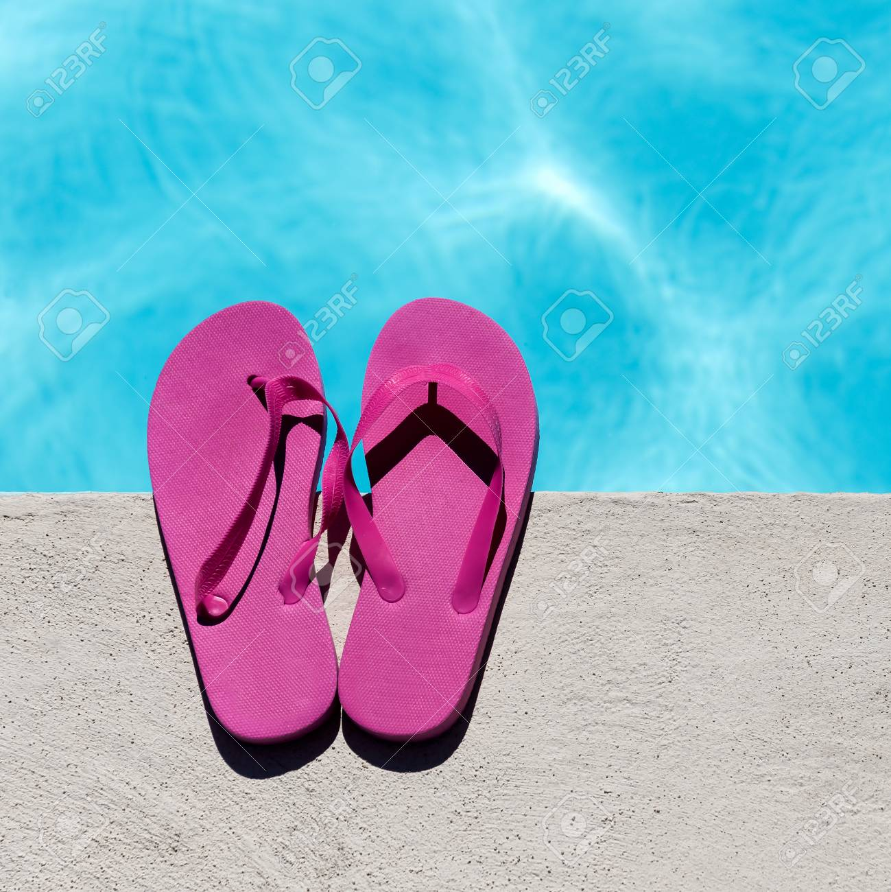432dc838b3bf2 Pink slippers near swimming pool at poolside