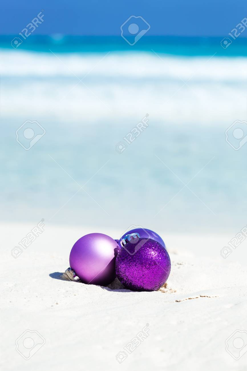 Christmas Card With Toy Balls On Sandy Beach On Sea Background ...