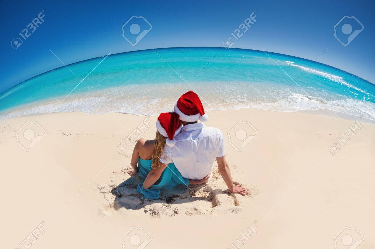 Tropical Christmas Greeting Card, Couple In Santa Hats Sitting ...