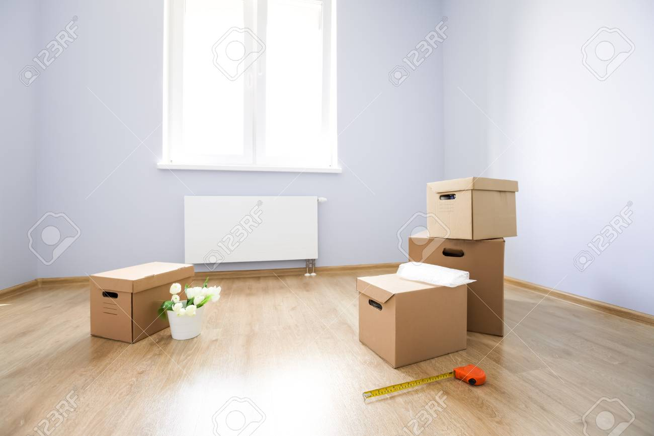 Cardboard Boxes On Laminate Floor In Empty Room Preparation