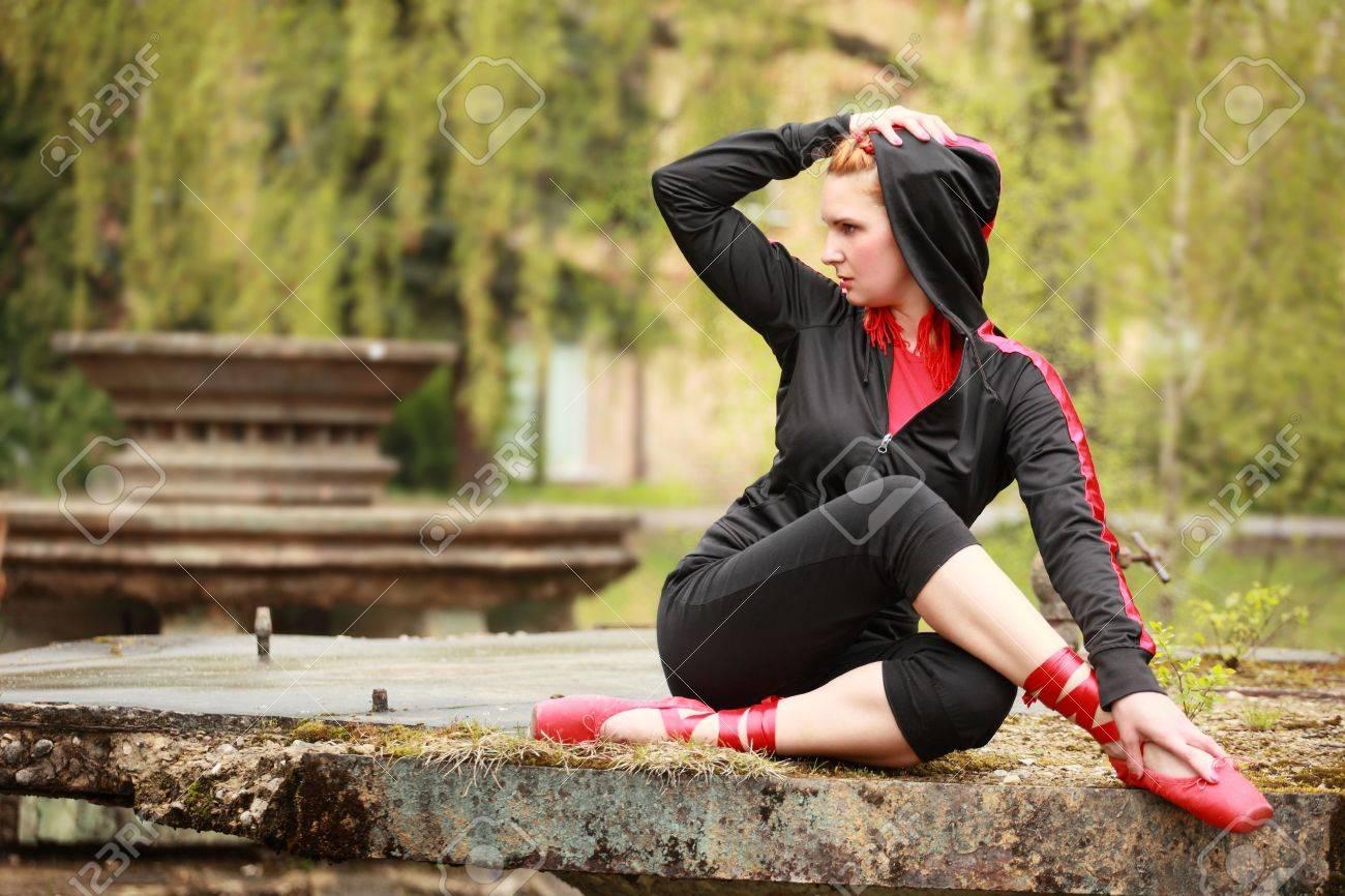ballet dancer posing on old fountain Stock Photo - 8804070