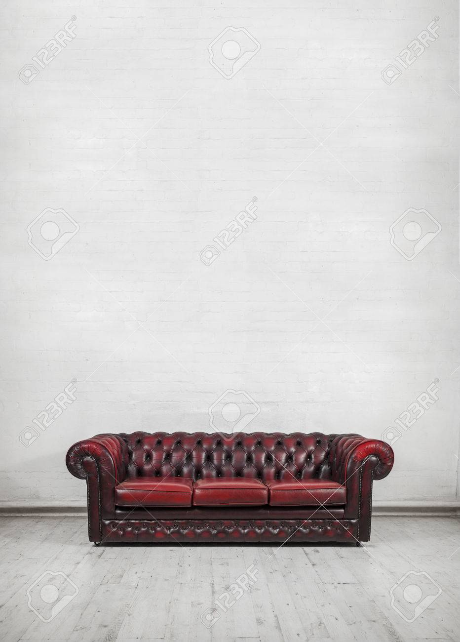 Awesome Oxblood Red Vintage Chesterfield Sofa Against Painted Brick Wall Bralicious Painted Fabric Chair Ideas Braliciousco