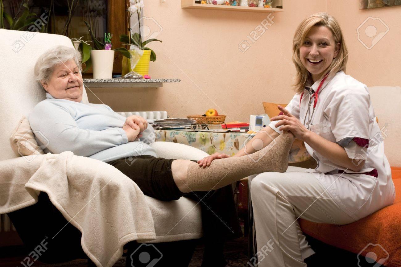 home visit nurse with senior Stock Photo - 12627209