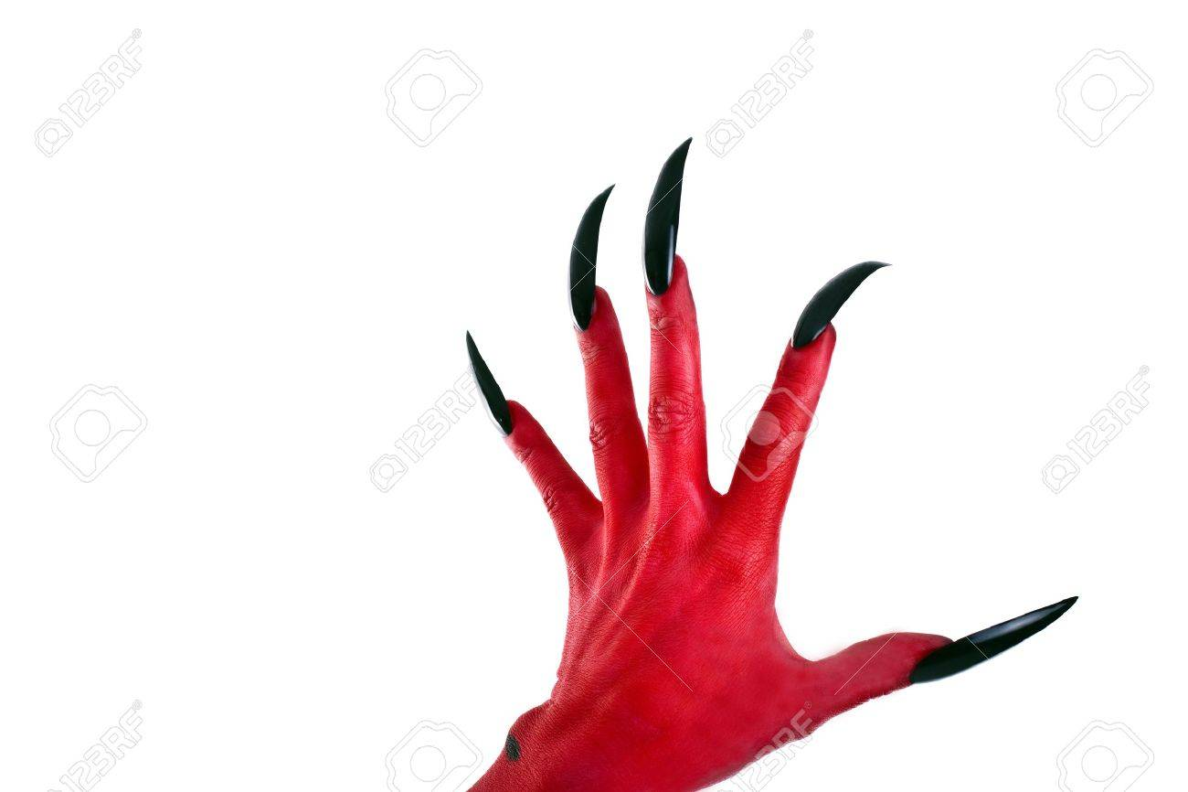 a red devil hand with black nails stock photo picture and royalty