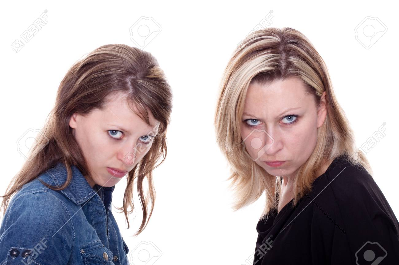 two beautiful young angry woman looking to the viewer Stock Photo - 13078444
