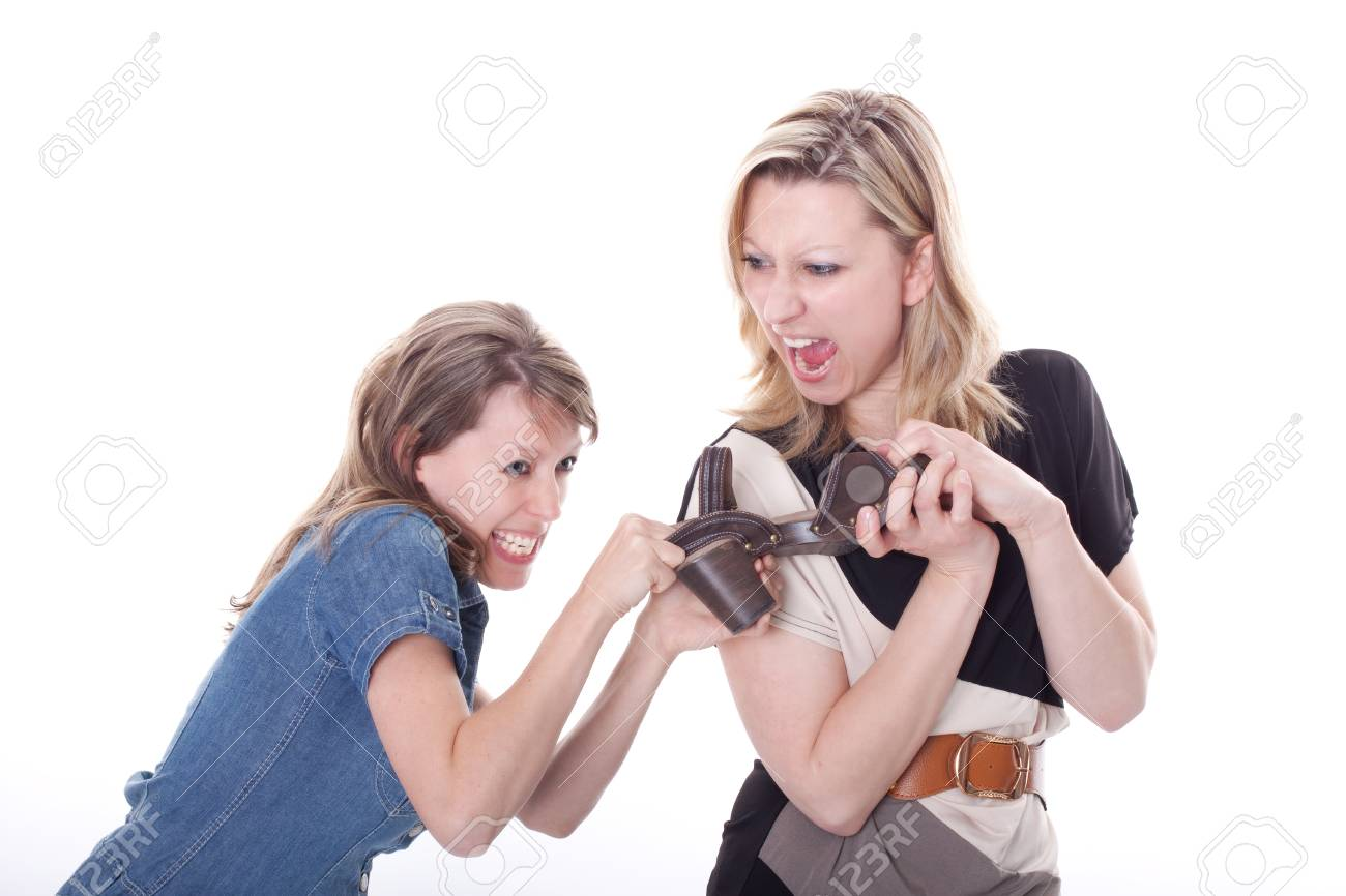 two beautiful young woman compete for a shoe Stock Photo - 13078431