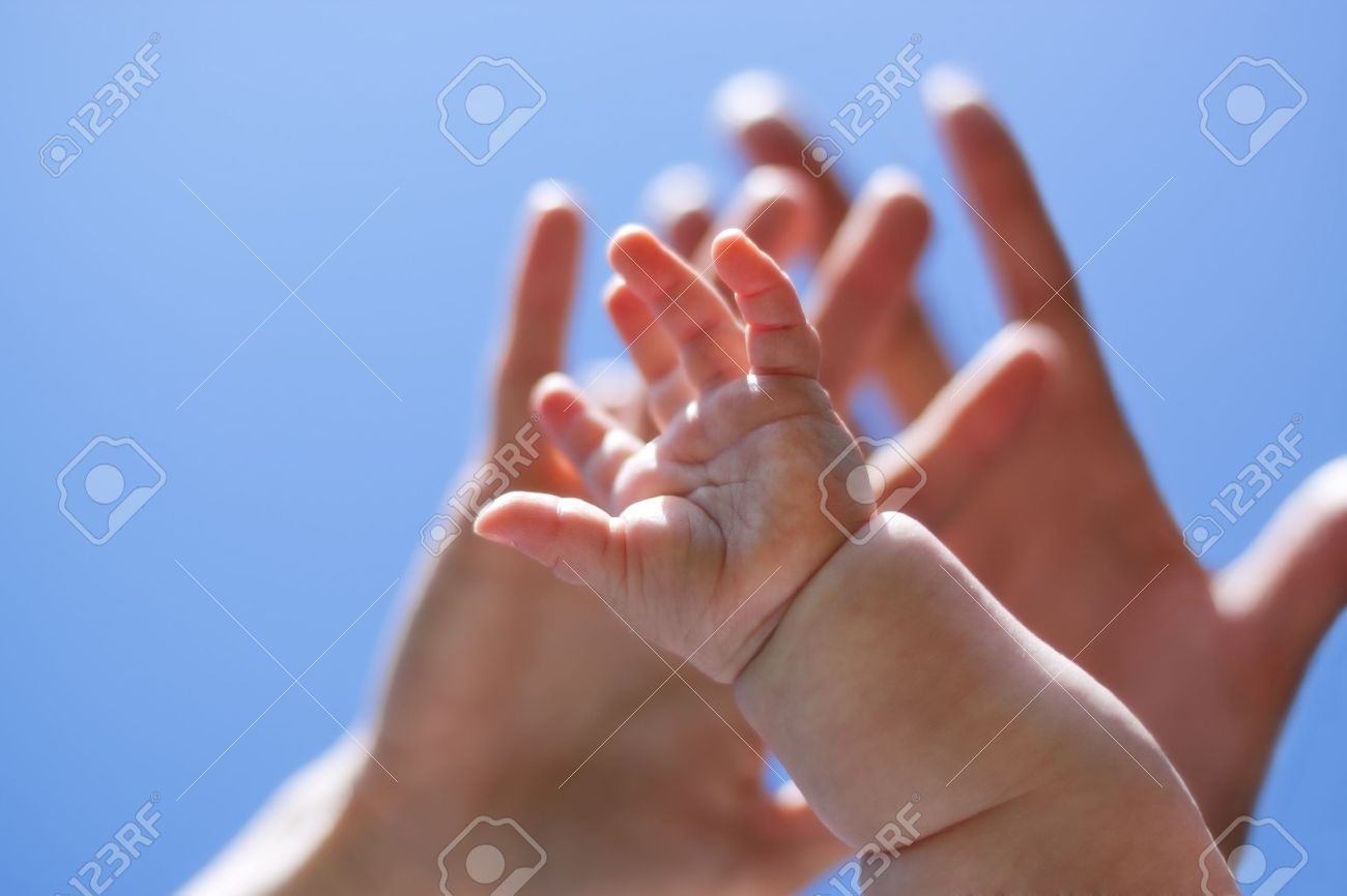 three hands from adults and baby stretch to the sky Stock Photo - 13612392