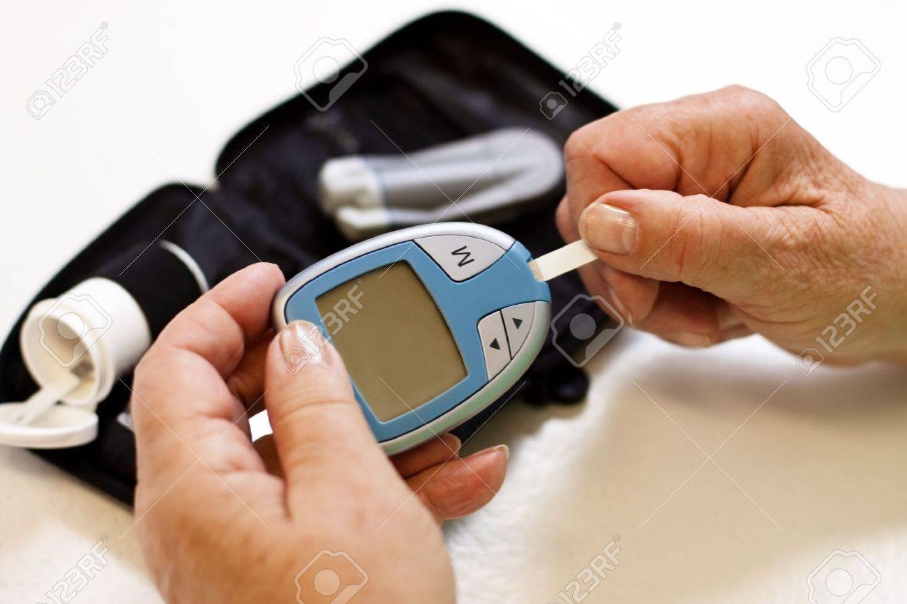 hands of senior with utensils of blood sugar test Stock Photo - 14407494