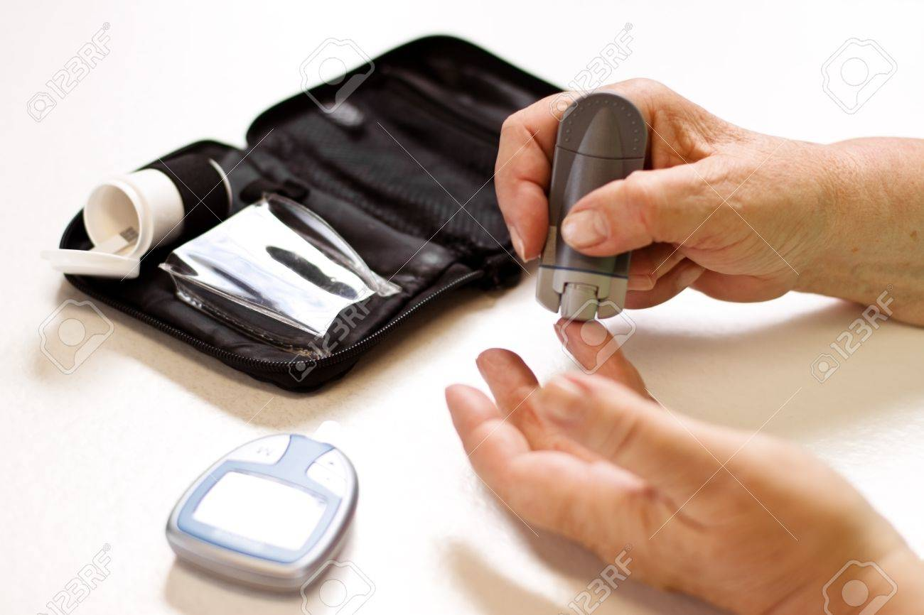 senior with equipment of blood sugar test Stock Photo - 14407489