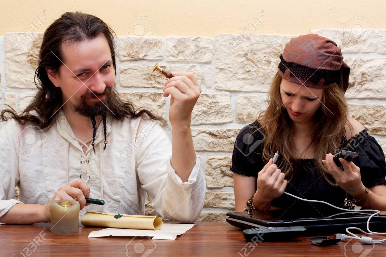 young woman is having problems with technology, man is clearly no better Stock Photo - 16972481