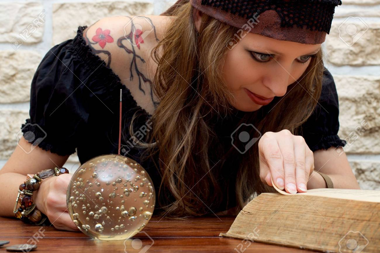 Fortune teller reads a book and suggests the future Stock Photo - 16972476