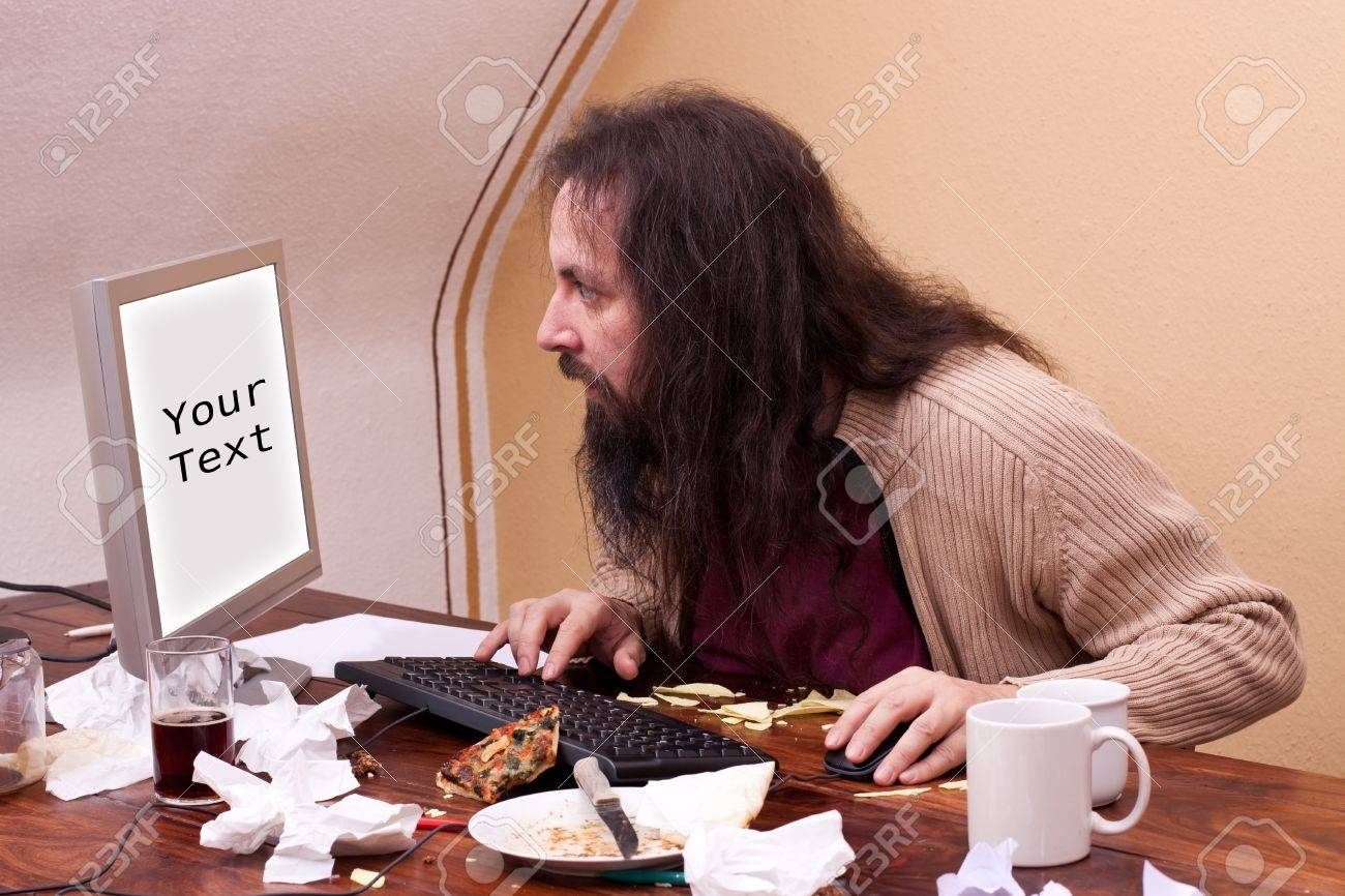 long haired nerd looks at monitor with space for text Stock Photo - 17643141