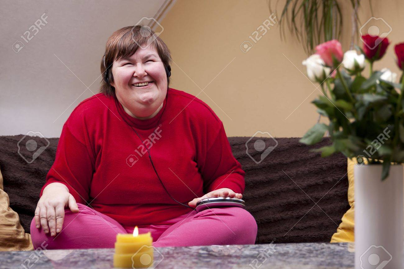 Disabled woman experiencing music and looks forward Stock Photo - 18876118