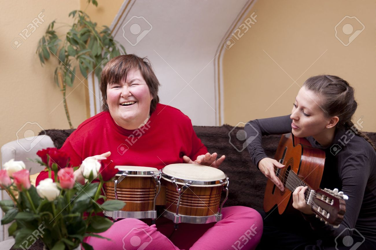 Two women make a music therapy and having fun Stock Photo - 18866754
