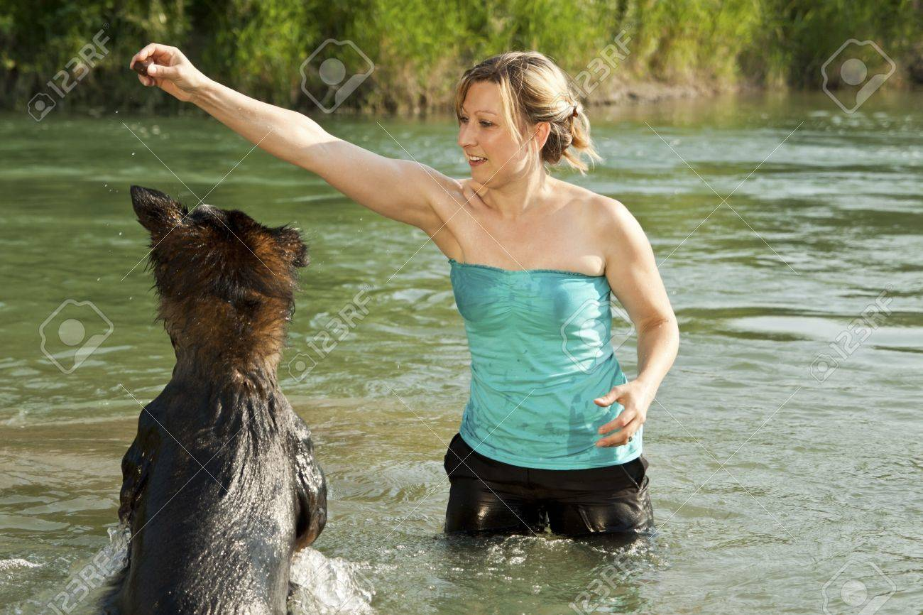 funny dog is jumping in the water Stock Photo - 21622152