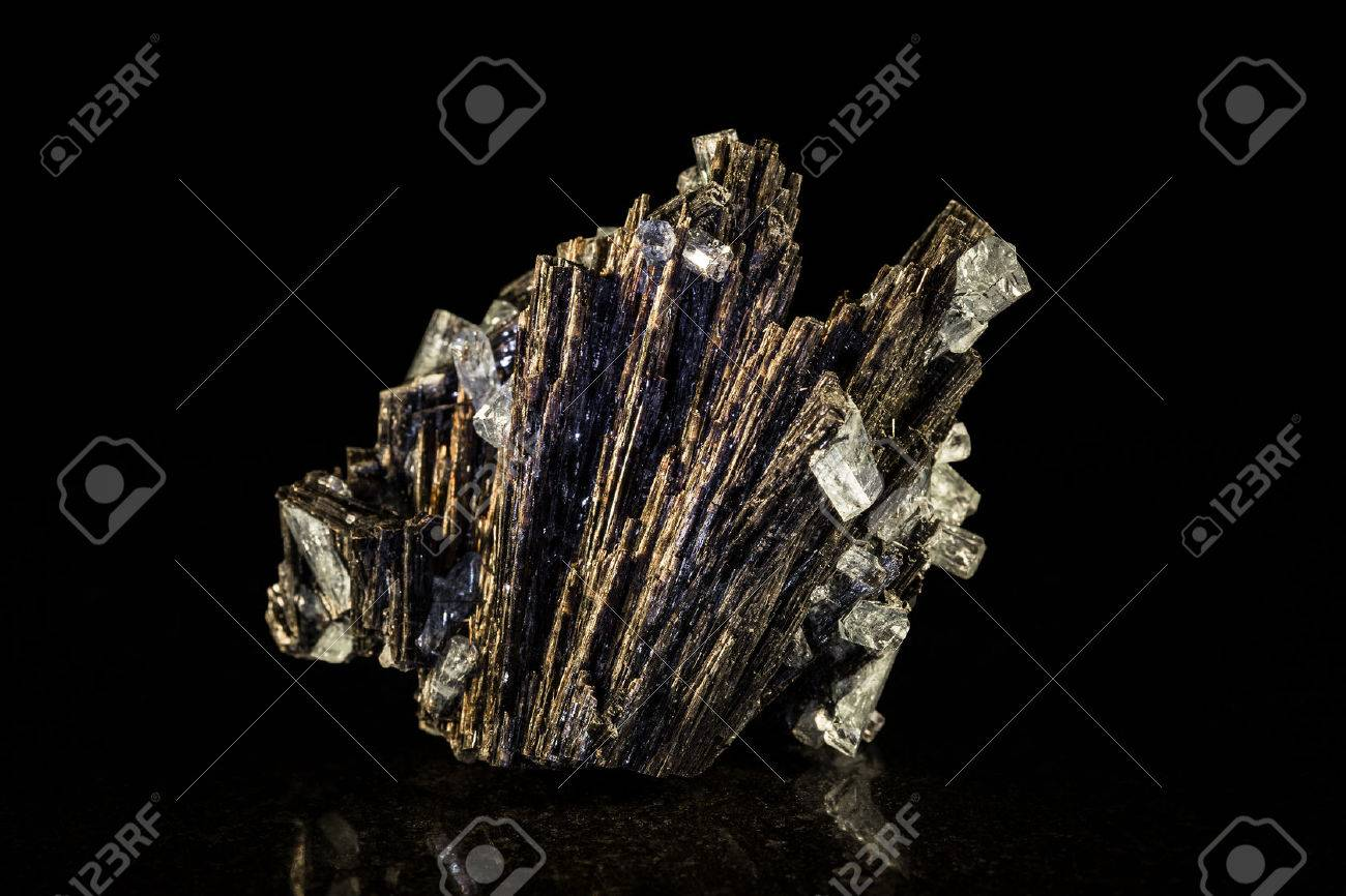 Black tourmaline an aquamarine crystal in front of black Stock Photo - 25122221