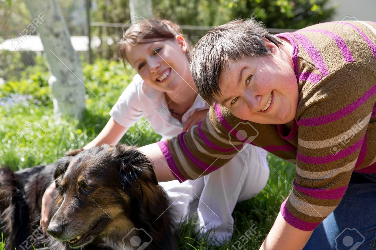 Coloring pages for down syndrome adults - Down Syndrome Two Women And A Half Breed Dog On A Field