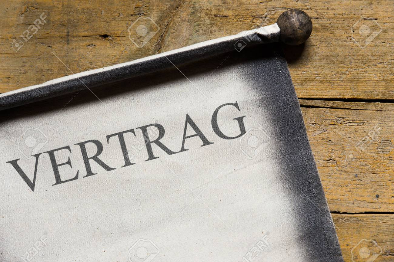 Old Scroll On Wooden Table, German Word Vertrag, Which Means.. Stock ...