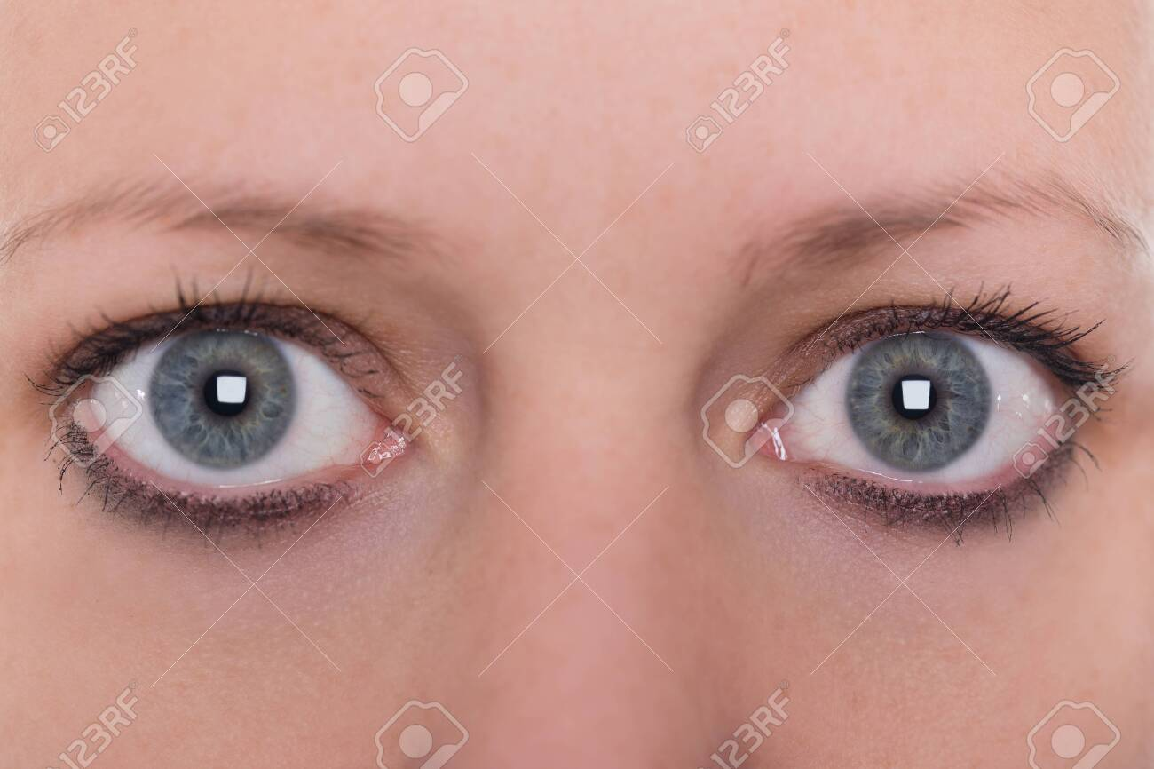 close up, blue eyes and eyebrows from a young woman - 122166910