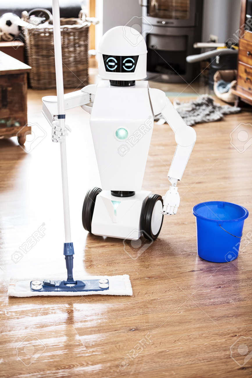 automatic robot floor scrubber is doing his work in an living room, vertical shot with copyspace - 168974764
