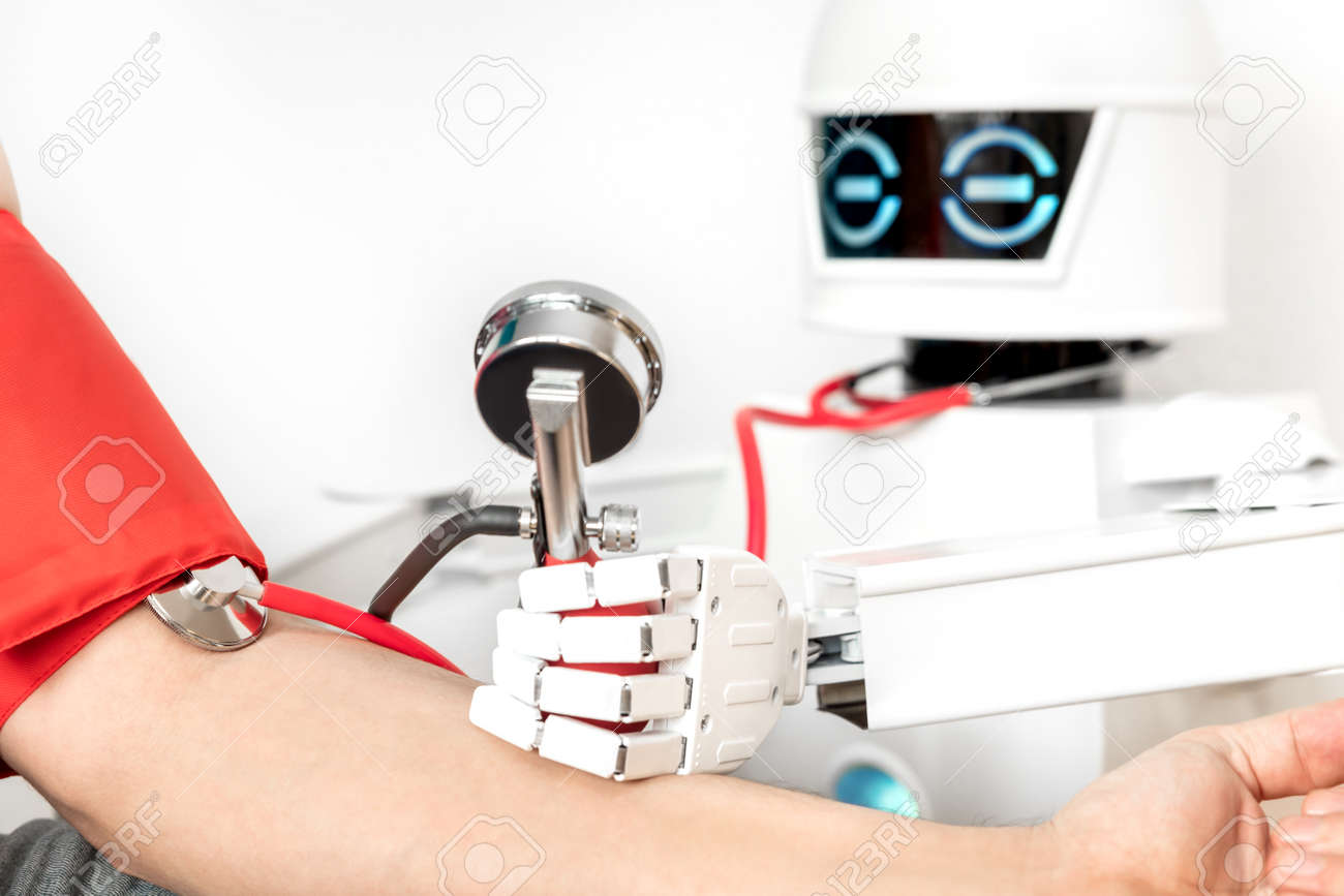 medical assistance robot is checking the blood pressure of a male patient while using a stethoscope - 168974773