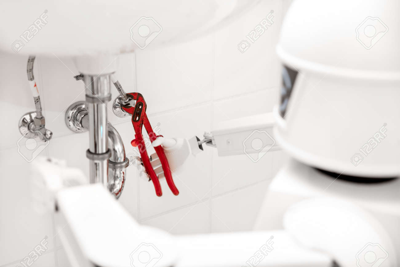 Autonomous service robot is fixing something in the bathroom, with an pipe wrench under the sink - 168974776
