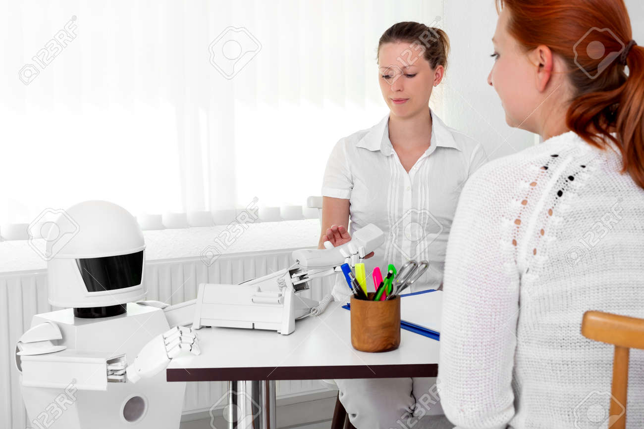 autonomous medical robot is giving a telephone to a female doctor in her office, while sitting behind her desktop - 170381911