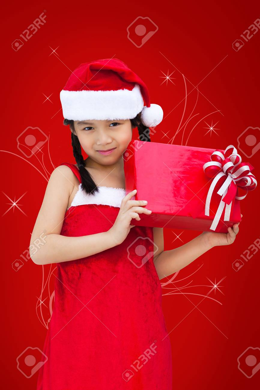 Little miss santa is happy about a gift Stock Photo - 16327550