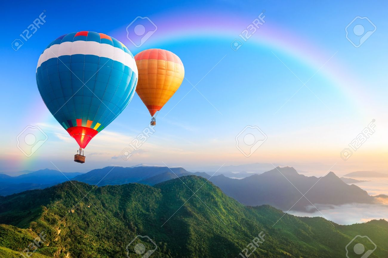 Colorful hot-air balloons flying over the mountain - 17766364