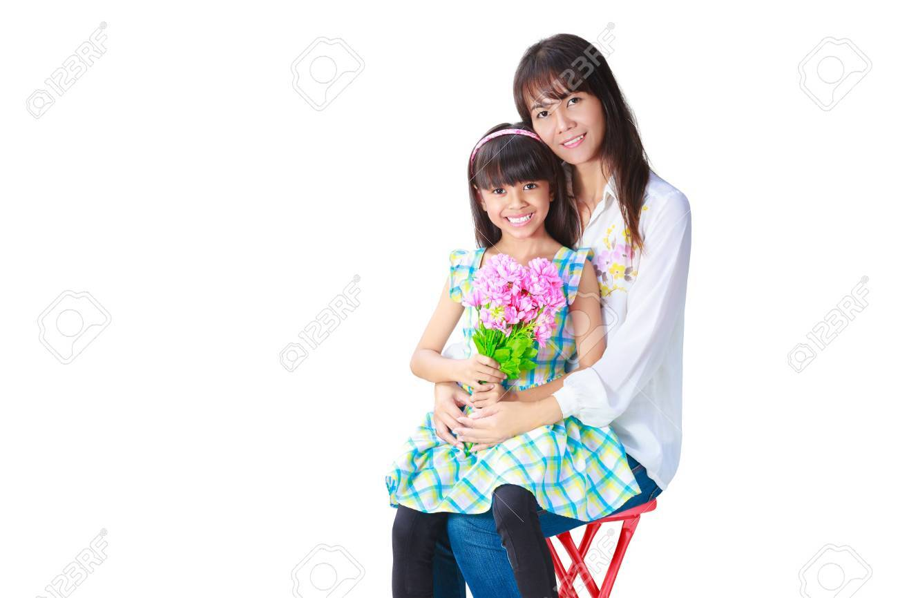 Mother hugging her daughter that have presented her the bunch of flowers, Isolated on white Stock Photo - 20174426