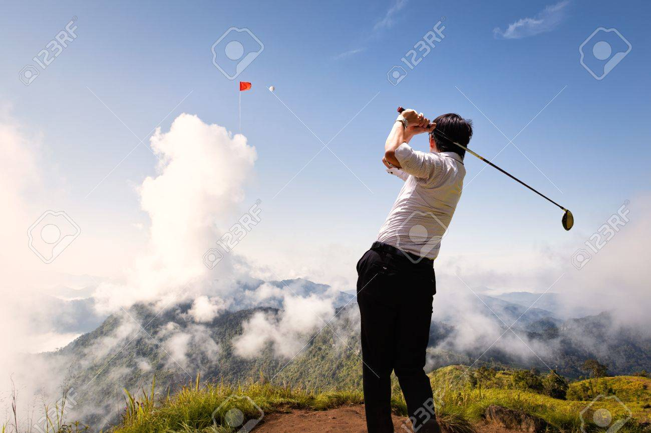 Young asian businessman hit golfball to flag on the cloud in the sky Stock Photo - 21285983