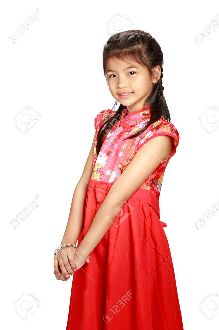 Little asian girl in traditional chinese cheongsam dress Stock Photo -  25088269