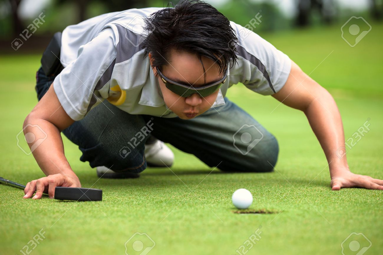 Desperate Golfer Blowing On Golf Ball To Put In Hole Funny Golfing Stock Photo Picture And Royalty Free Image Image 29868280