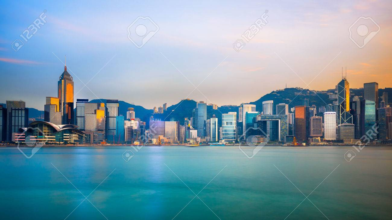 Hong Kong skyline in the evening over Victoria Harbour - 39807589