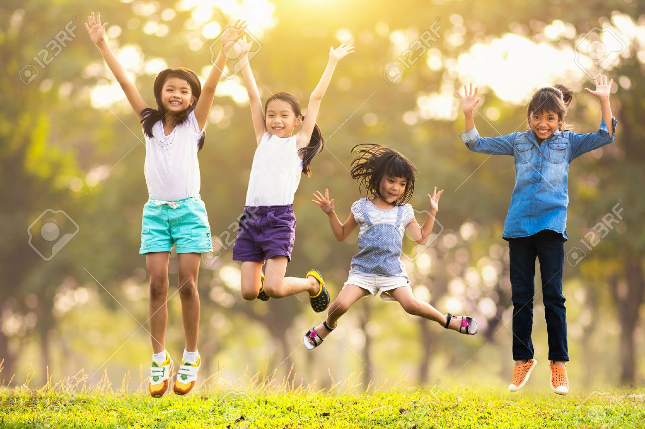 Joyful happy asian family jumping together at outdoor park - 52257442