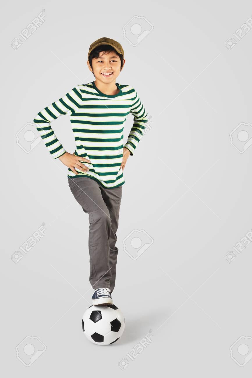 Asian boy standing