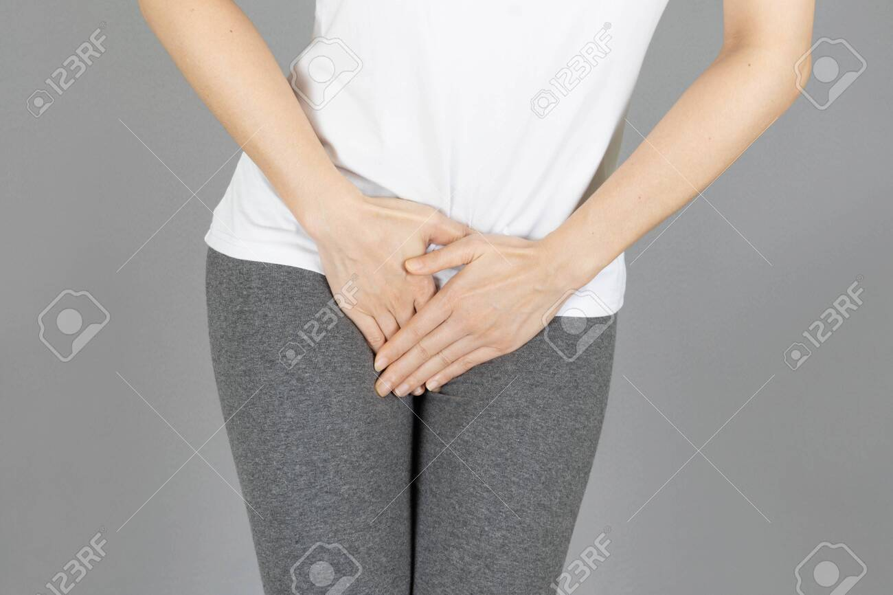 crop image of hand on the crotch area,Penis pain.Health-care,urinary,infection, incontinence,bladder,dysmenorrhea concept on gray background - 148494230