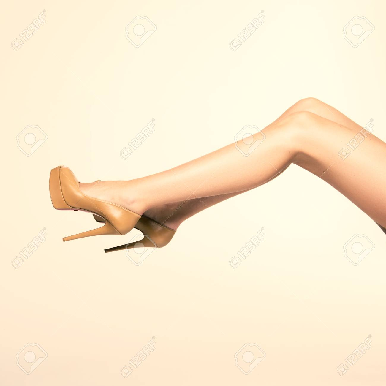 2d4b0b68aee6d7 Photo of sexy shapely seductive female legs in the studio stock photo jpg  1300x1300 Shapely tanned