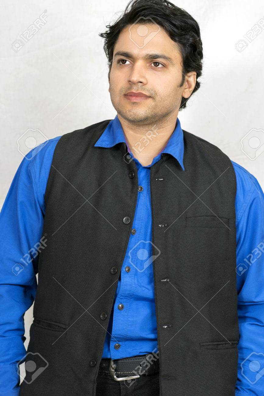 1c76910ffc indian male model with half jacket and blue shirt Stock Photo - 71467798