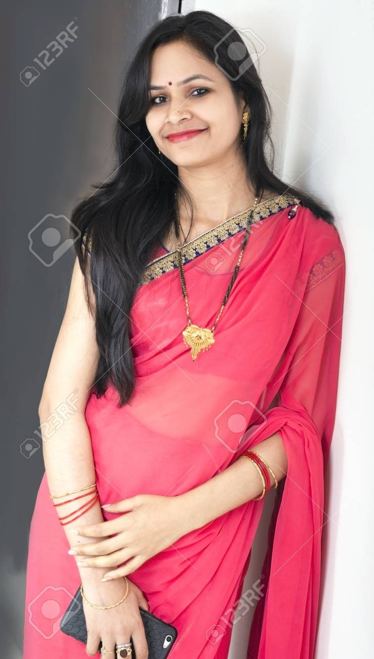 c896aea4547 indian married women front pose wearing red saree Stock Photo - 73189492