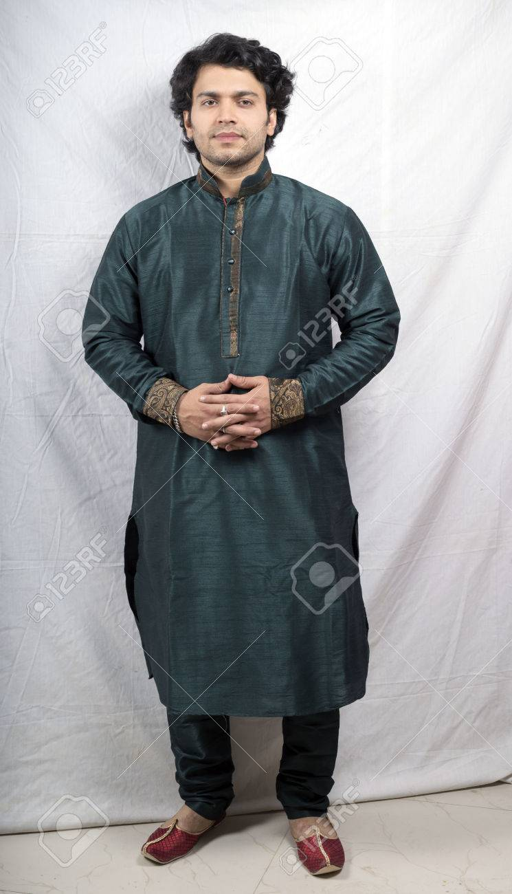 Indian Male Model In Green Kurta Holding Hands Front Pose Stock Photo Picture And Royalty Free Image Image 77708433