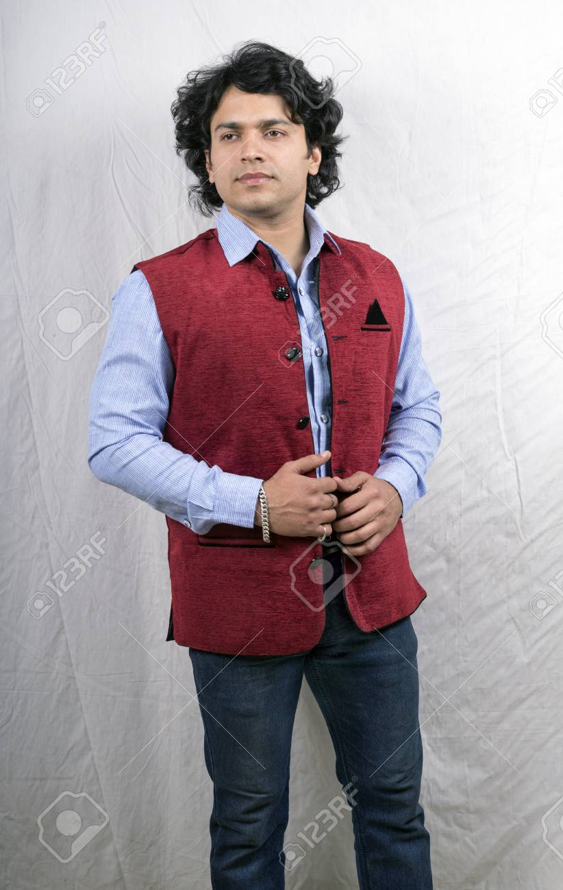 40b8a118d6 indian male model in light blue shirt and red half jacket Stock Photo -  92024460