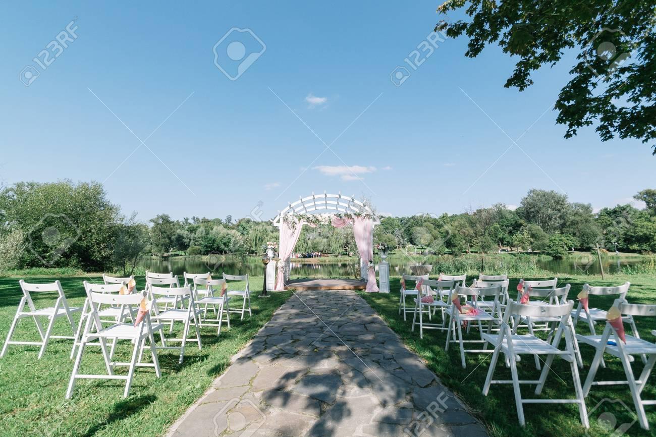 Sensational Beautiful Summer Wedding Ceremony Outdoors Decorated Chairs Interior Design Ideas Clesiryabchikinfo