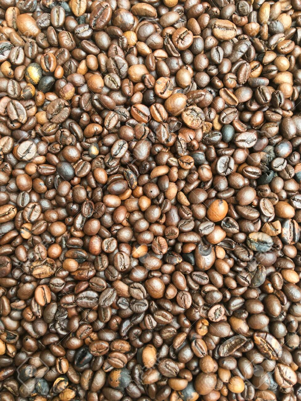 a bunch of coffee beans are lying on the table. coffee texture and background image - 147685287