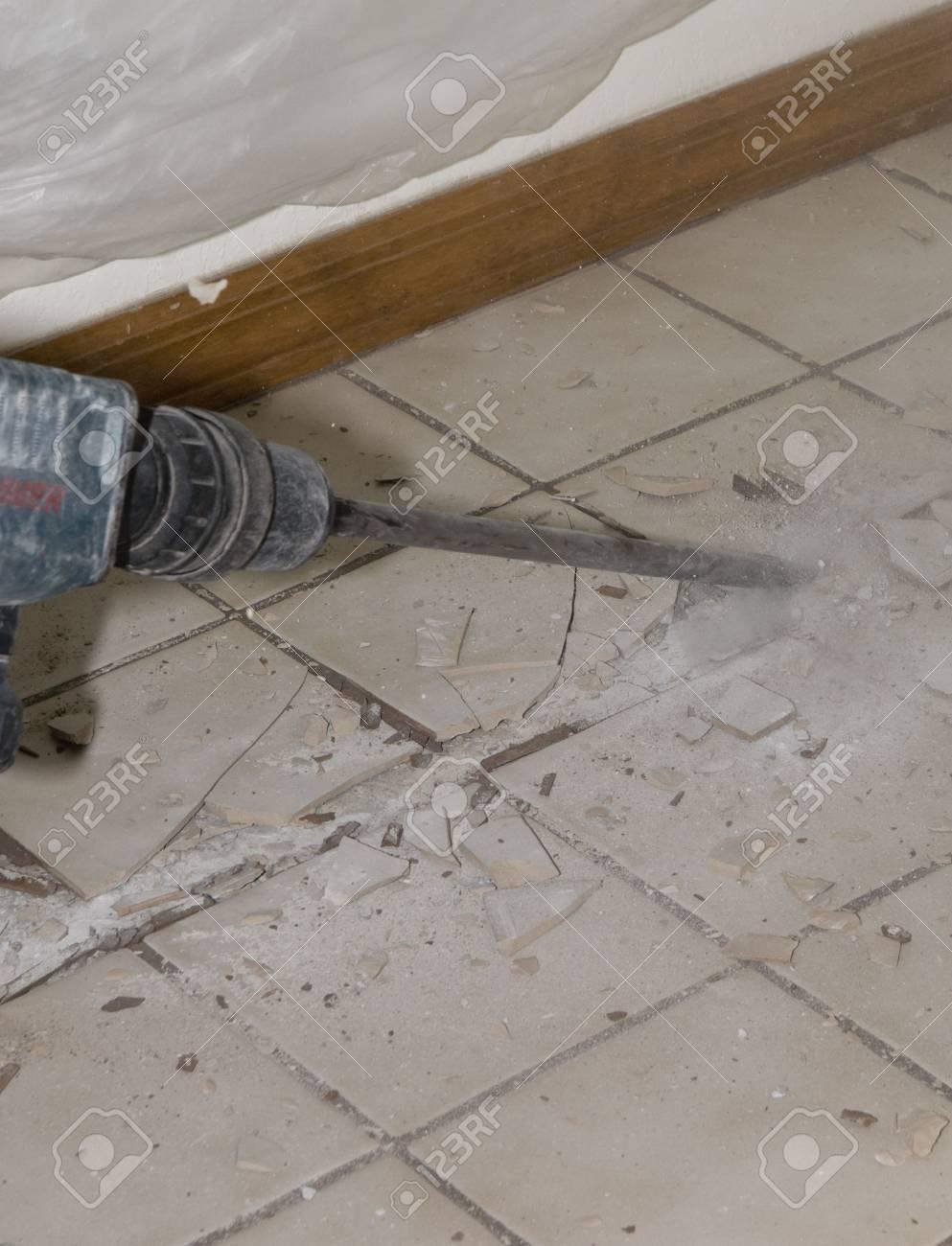 Photo image of ceramic tile floor demolition during homw photo image of ceramic tile floor demolition during homw renovations stock photo 6067883 dailygadgetfo Images